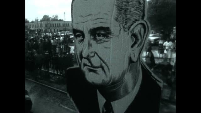 Johnson 1964 Presidential Campaign Train with caricature in the window Shot from behind of LBJ at a stop on the tour
