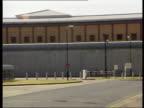 London Belmarsh Prison Prison PAN MS Wall and prison windows seen beyond LMS Open prison window Police van towards thru entrance barrier