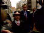 Jonathan Aitken jailed LIB Jonathan Aitken along thru press to court