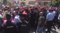 Jordanian protesters shout slogans and wave their flag during a demonstration near the Israeli embassy in Amman Jordan on July 28 2017 Protestors...