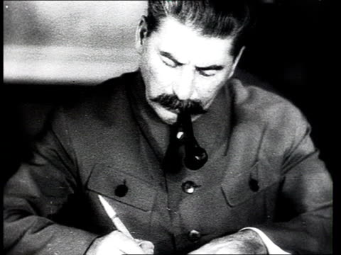 Joseph Stalin smoking pipe and writing at desk / Kremlin Moscow Russia