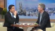 Josh Elliott interviewing Chef Anthony Bourdain on the set of Good Morning America in New York NY on 1/14/13