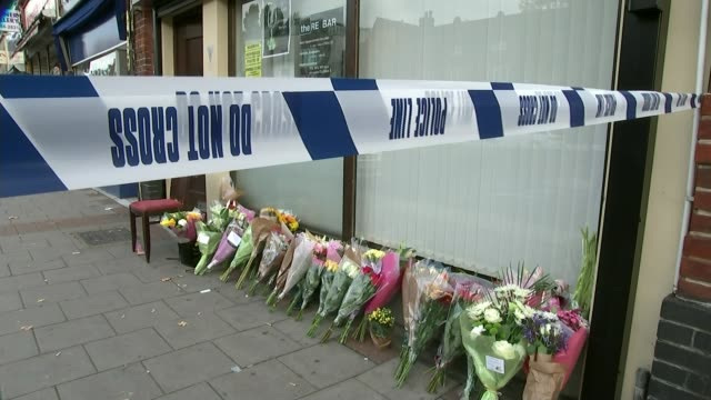 50000 pound reward offered for suspect Shane O'Brien T21101519 / TX Sign 'The RE Bar' Floral tributes and police tape cordon Various shots of floral...