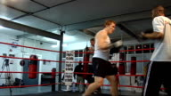 Josh Lewsey interview ENGLAND London INT Lewsey in boxing ring sparring with unidentified man **Lewsy interview overlaid SOT**