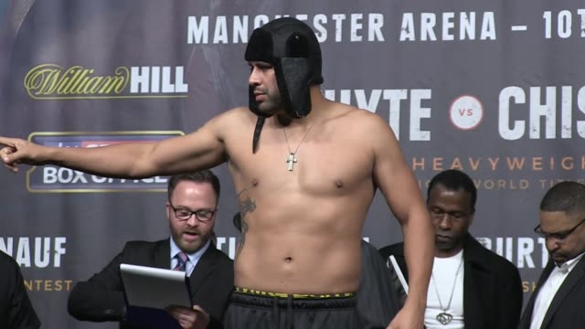 Joshua and Molina weighin before fight ENGLAND Manchester INT Heavyweight boxers Anthony Joshua and Eric Molina posing face to face for photocall...