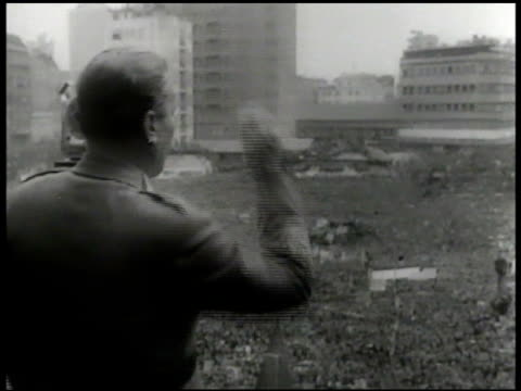 Josip Tito speaking to crowd on balcony large crowd FG HA WS Yugoslavian crowds w/ signs HA MS Tito on balcony w/ men saluting speaking