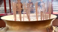 HD: joss stick and candle flame
