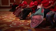 Journalists and supporters of Democratic candidates prepare for the first Democratic presidential debate at the Wynn Las Vegas resort and casino in...