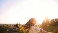 SLO MO Joyful girl blowing dandelions