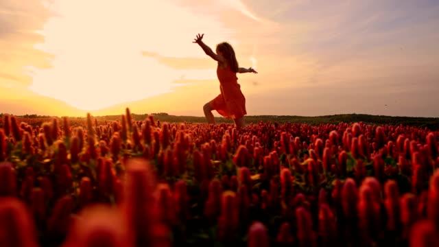 SLO MO Joyful girl in field of crimson clover