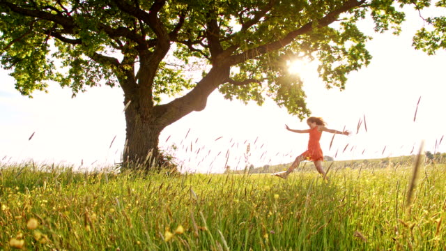 SLO MO Joyful girl in the meadow
