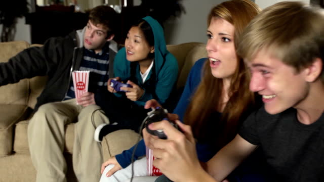 Joyful Teens Play with Video Game