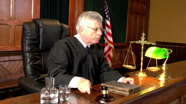 Judge in Court using Gavel - Two Shots USA Flag