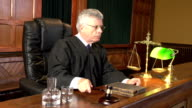 Judge in Court using Gavel (Courthouse) - Two Shots