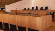 A judge's bench faces an empty courtroom.