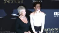 Judi Dench and Emma Watson at the 2014 BAFTA Los Angeles Jaguar Britannia Awards Presented by BBC America and United Airlines in Los Angeles CA on