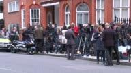 Swedish prosecutors drop rape investigation ENGLAND London EXT Various of crowd of press waiting outside the Ecuadorian embassy waiting for an...