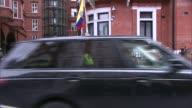 Swedish prosecutors drop rape investigation ENGLAND London EXT Press outside the Ecuadorian embassy Ecuadorian flag flying from balcony of embassy...