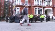 Swedish prosecutors drop rape investigation ENGLAND London Various of press outside the Ecuadorian embassy Assange back into embassy from balcony