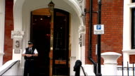 General views of Ecuadorian Embassy Police officer outside embassy / 'Hans Crescent' sign with Harrods shop in background / Harrods PAN Ecuadorian...