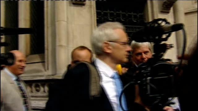 Julian Assange goes to High Court to try to block extradition to Sweden ENGLAND London High Court EXT Julian Assange along and waving outside court...