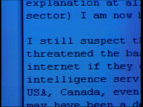 Julian Rush looking at computer screen with email from Richard Tomlinson CS email PAN