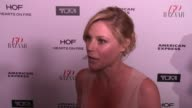 INTERVIEW Julie Bowen on what brings her out talks her goto red carpet looks and who her style icons are at the Harper's BAZAAR Celebrates 150 Most...