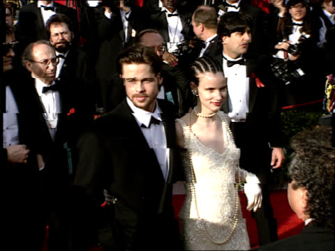 Juliette Lewis and Brad Pitt walk down the red carpet at the 64th Annual Academy Awards