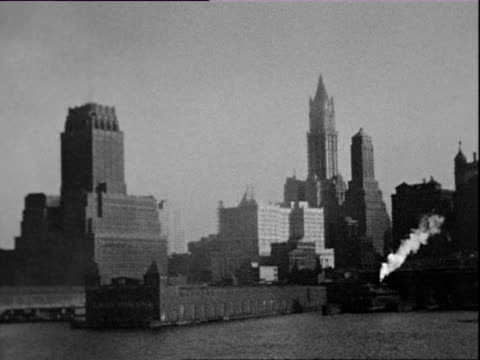 July 1938 B/W MONTAGE Manhattan skyline, Statue of Liberty, ferry passing seen from moving ship / New York City, New York, USA