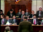 July 1987 Oliver North Daniel Inouye sit down after swearing in during IranContra hearing