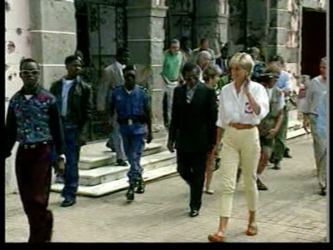 July 1997 MS PAN Princess Diana walking with local officials and Red Cross workers to survey damage done by land mines/ TU Building/ MS Diana talking...