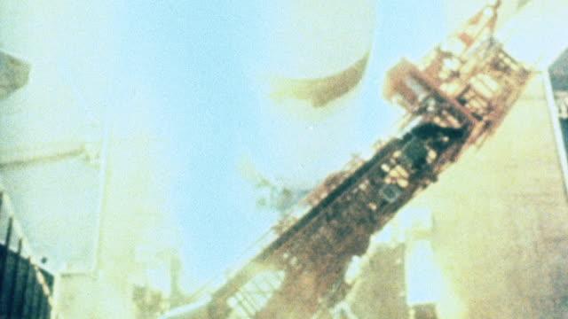 July 26, 1971 MONTAGE Apollo 15 and Saturn V lifting off / Merritt Island, Florida, United States