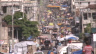 July 7 2010 TU Long street in commercial district packed with pedestrians and traffic / PortauPrince Haiti
