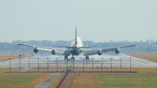 Jumbo jet airplane landing to runway , 4K(UHD)