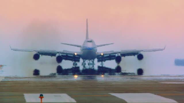 Jumbo jet (Air China) lands in early morning haze at San Francisco International airport, extreme telephoto perspective