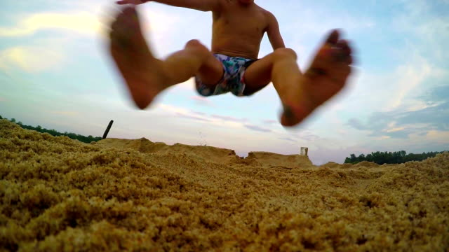 Jumping contest on the beach. Summer holiday fun