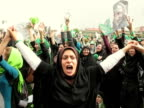 9 Jun 2009 MS PAN Female protestors holding hands and shouting during demonstration on street / Teheran Iran / AUDIO
