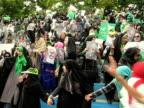 9 Jun 2009 WS HA PAN Female protestors holding placards and posters during demonstration on street / Teheran Iran / AUDIO