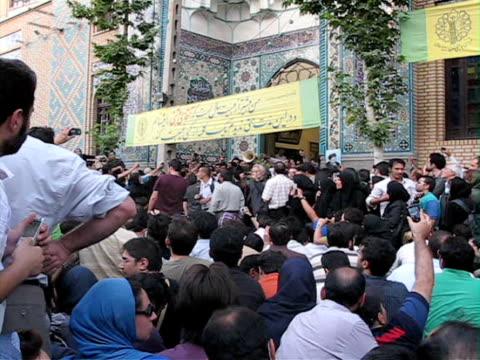 28 Jun 2009 WS Large group of demonstrators standing outside mosque / Teheran Iran / AUDIO