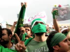 9 Jun 2009 MS PAN Large group of men dressed in green demonstrating on street / Teheran Iran / AUDIO