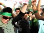 10 Jun 2009 MS POV Large group of people shouting and clapping during street demonstration / Teheran Iran / AUDIO