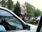 13 Jun 2009 WS POV ZI Protesters walking and shouting on street amongst traffic / Teheran Iran / AUDIO