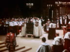 June 2 1953 clergyman carrying crown to Queen Elizabeth II during coronation ceremony / documentary