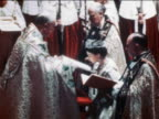 June 2 1953 Queen Elizabeth II kissing book held by clergy during coronation ceremony / documentay