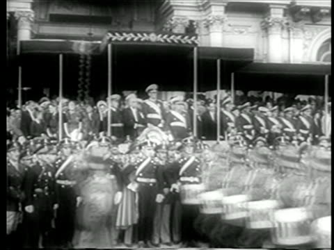 B/W June 4 1946 Juan Peron in uniform in background as soldiers march in parade in his honor / Buenos Aires