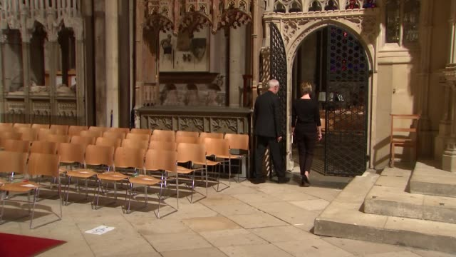 Justin Welby interview **Organ music heard** Most Reverend Justin Welby in cathedral with reporter / Welby and reporter in choir along aisle /...