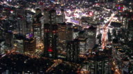 Kabukicho often called 'sleepless town' is highlighted by myriad of lights behind Tokyo Metropolitan Government