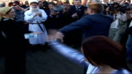 Kadyrov dancing in centre of crowd with unidentified women SOT * * FLASH
