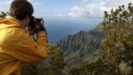 WS Kalalau Valley, man photographing view, Na Pali Coast, Kauai, Hawaii, USA