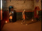 Kalaripayattu students perform their morning rituals before starting practice for the day